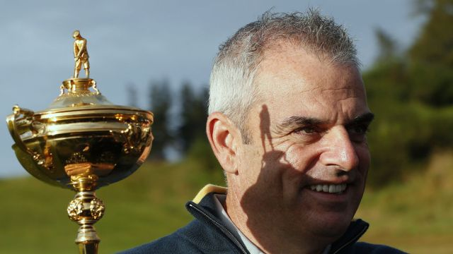 Europe captain Paul McGinley holds the trophy ahead of the 2014 Ryder Cup (Reuters)